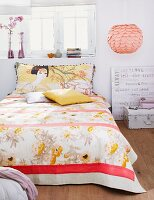 Bed with Japanese pattern on bedspread & pillow