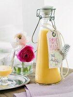 Homemade eggnog in a flip-top bottle as a gift