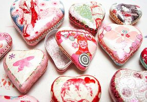 Carefully decorated heart-shaped paper boxes