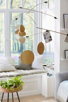 A mobile with memo holders as room decoration