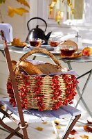 Wicker basket decorated with rosehips