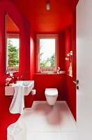Guest toilet painted vivid red