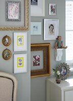 A collection of pictures in decorative frames