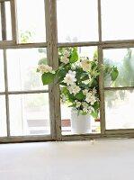 A bunch of jasmine on a windowsill