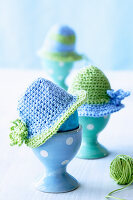 Egg cups with crocheted hats