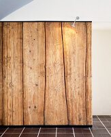 Illuminated wall of rustic wooden planks