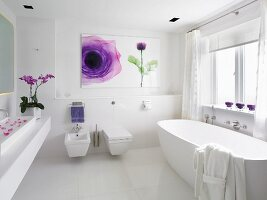 White designer bathroom with modern picture with floral motif on wall
