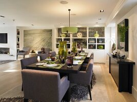 Festive set table with upholstered chairs in modern dining room