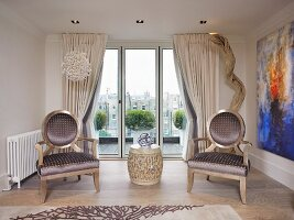 Retro chairs with upholstered seats and backs in modern room