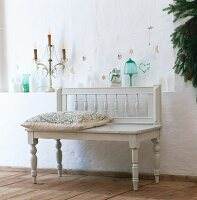 White bench in front of Christmas decor