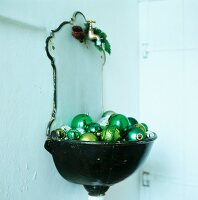 Fountain wall sink with green baubles