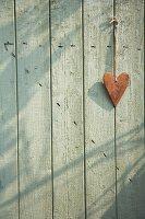 Heart hanging on a wooden door