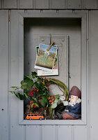 Ornaments in niche in board wall