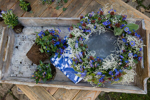 Wreath of gentian flowers and cushion bush sprigs