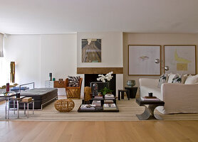 Two sofas facing one another, coffee table, side tables, Mexican armchair and wooden stool in spacious living room