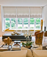 Coffee table, Mexican armchair, leather sofa and cushions on window sill in living room