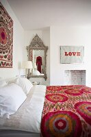 Romantic bedroom with jazzy, playful and antique elements