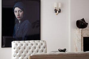 Modern portrait of woman behind quilted back of elegant recamiere in postmodern living room