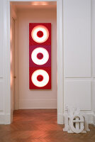 Wood-panelled doorway leading to hall with view of red 70s light sculpture