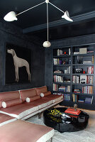 Cool atmosphere in living room with portrait of gun dog and anthracite walls