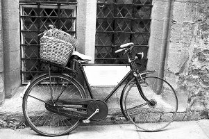 Old bicycle in front of house