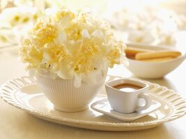 Bowl of Flowers with a Cup of Coffee on a Platter
