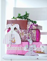 Wrapped presents hung with paper decorations