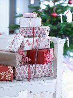 Wrapped presents stacked on chair