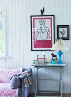 Console table below framed pictures