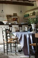 Rustic kitchen-dining room with wooden table