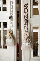 Lavender bags hanging from keys in cupboard locks