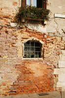 Weathered Wall on Canal in Venice Italy
