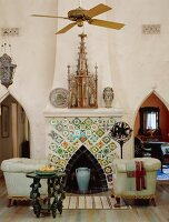 Classic 19th century style - Gothic and Art Noveau influences meet in the living room with a mosaic fireplace and pointed arch passageways