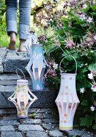 Hand-crafted lanterns on garden steps