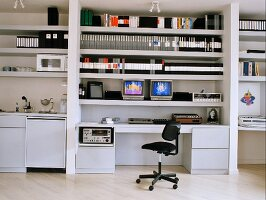 Open-plan living with office and kitchen areas