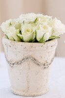 White roses in plant pot