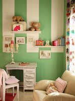 Green wall with white stripes in child's bedroom