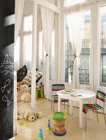 Playroom with floor-to-ceiling windows