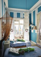 Child's bedroom with twin beds and blue walls