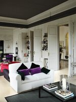Elegant salon with sofa sets and white double doors