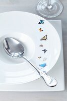 Tape with butterfly motif on deep dish with soup spoon