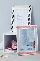 White picture frames decorated with patterned tape