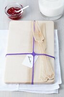 Breakfast board with name card and purple rubber band
