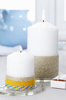 Pillar candles decorated with twine and cord