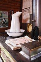 Old pitcher and wash bowl on vintage cooker