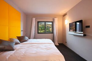 Yellow headboard above bed