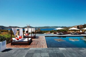 Pool beds by outdoor swimming pool