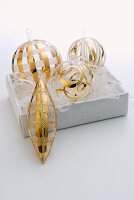 Set of glass Christmas baubles with delicate gold stripes in white box