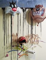 Modern coat rack with various coathangers decorated with cartoon character foil balloons
