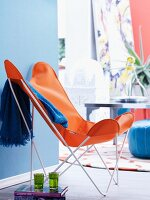 Orange butterfly chair and green, Moroccan tea glasses